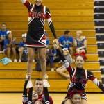 'Iolani School Varsity cheerleaders competed.