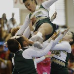 Leilehua flyer Jolanie Martinez is caught by other members of the squad during their performance.