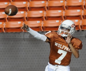 Pac-Five quarterback Anthony Canencia threw a pass in the first quarter against Radford on Saturday, Aug. 10, 2013. (Bruce Asato / Star-Advertiser)