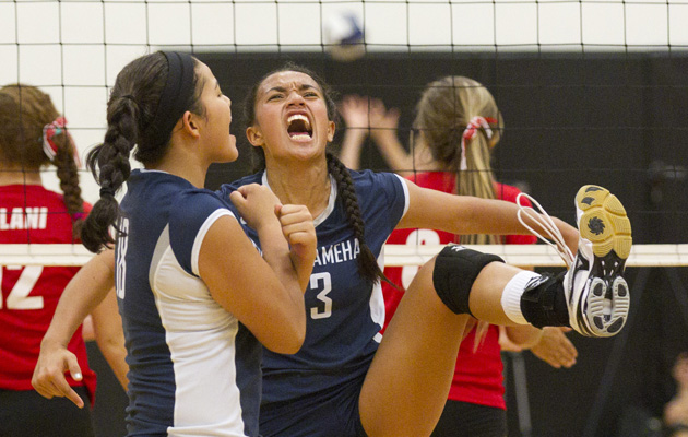 Kamehameha's Tiyana Hallums celebrated a kill against 'Iolani along with teammate Payton Spragling on Sept. 14, 2013. (Cindy Ellen Russell / Star-Advertiser)