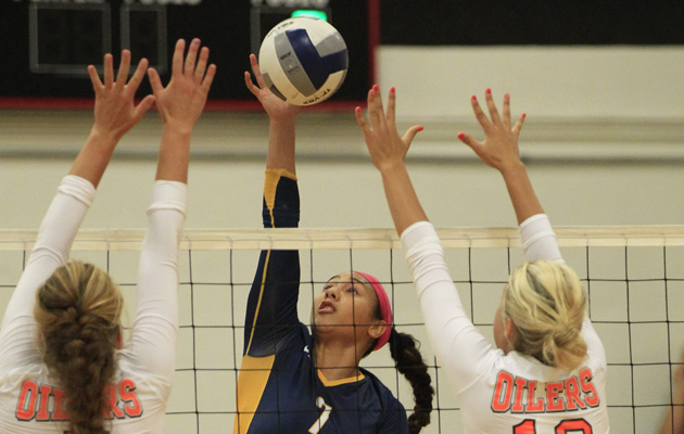 2013 Aug 17 SPT - Punahou's Remo Gaogao hits against Huntington Beach's (L-R) Samantha Brennan and Gianna Guinasso in the championship round of the Ann Kang Volleyball Tournament on Saturday. Honolulu Star-Advertiser Photo by Krystle Marcellus