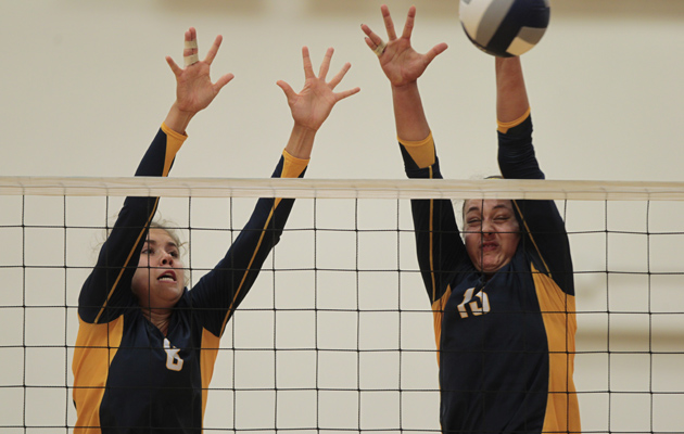 Punahou's Mariah Rigg, left, and McKenna Granato went up for a block against Mira Costa. (Dennis Oda / Star-Advertiser)
