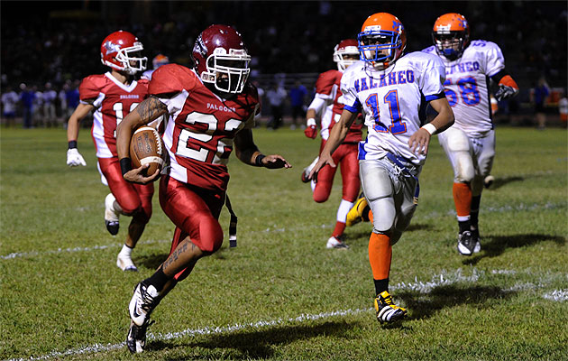 Kalani's Gavin Kim outran Kalaheo defenders in the Falcons' win over the Mustangs last year. Photo by Bruce Asato.