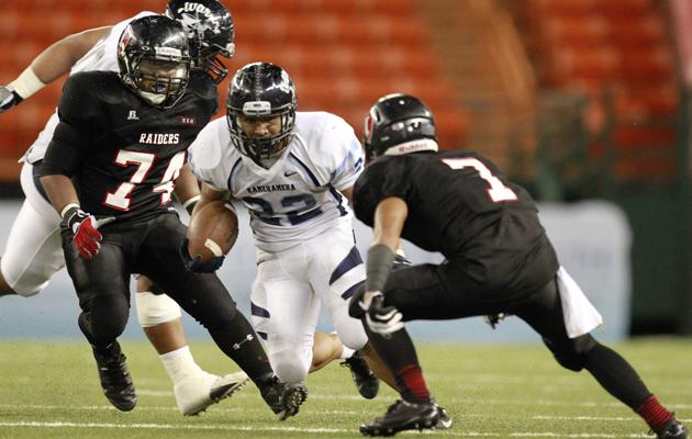 Brandon Kahookele picked up yards against 'Iolani on Friday night at Aloha Stadium.(George F. Lee / Star-Advertiser)