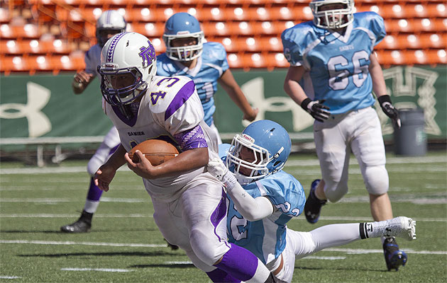 Edwin Aumua leads Damien with four rushing touchdowns. Honolulu Star-Advertiser photo by Cindy Ellen Russell