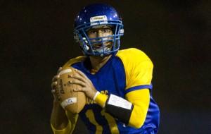 Kaiser quarterback Kahoalii Karratti has the Cougars undefeated in the OIA White.