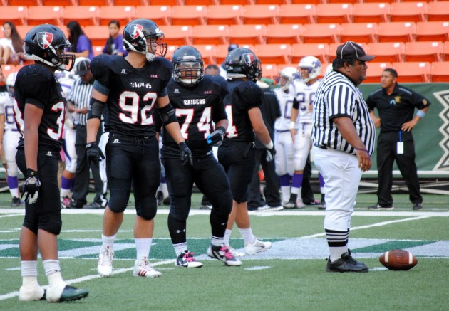 'Iolani defensive tackle Marc Ma towered over both lines in the ILH championship on Friday.