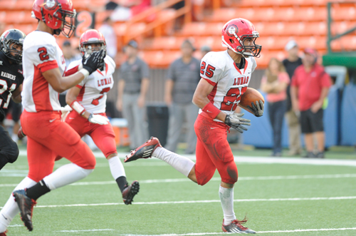Scott-Isaac Medeiros-Tangatailoa scores a touchdown for Lahainaluna in last year's Division II state final against 'Iolani. (Bruce Asato / Star-Advertiser)
