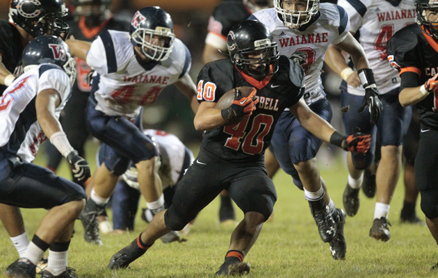 Campbell's Austin May tried to outrun Waianae's defense on Friday night. (Jamm Aquino / Star-Advertiser)