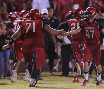 Kahuku's Henry Tonga, left, celebrated with Jacob Samsel after a fumble recovery for a touchdown against Waianae. (Jamm Aquino / Star-Advertiser)