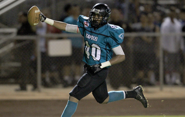 Kapolei's Alika Sene-Bailey celebrated a touchdown against Kailua on Friday night. (Jay Metzger / Special to the Star-Advertiser)