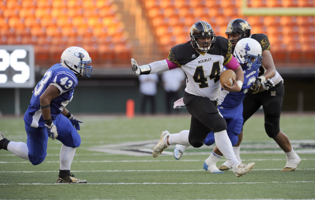 McKinley's Mathias Tuitele-Iafeta carried in the second quarter against Kailua at Aloha Stadium. (Bruce Asato / Star-Advertiser)