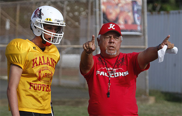 Under the tutelage of quarterbacks coach Howard Peralta, senior Noah Brum has Kalani playing in its first-ever playoff game. PHOTO BY DENNIS ODA.