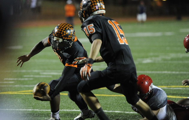 Campbell QB Isaac Hurd lunged for the end zone in the OIA playoffs against Kahuku. (Bruce Asato / Star-Advertiser)