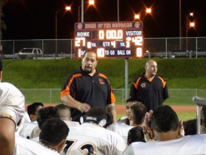 Campbell coach Amosa Amosa talks with his team after a win over Hilo. (Paul Honda / Star-Advertiser)