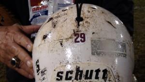 "A Konawaena helmet bears a maroon ""29"" in memory of Farrington's Dayne Ortiz. (Paul Honda / Star-Advertiser)"