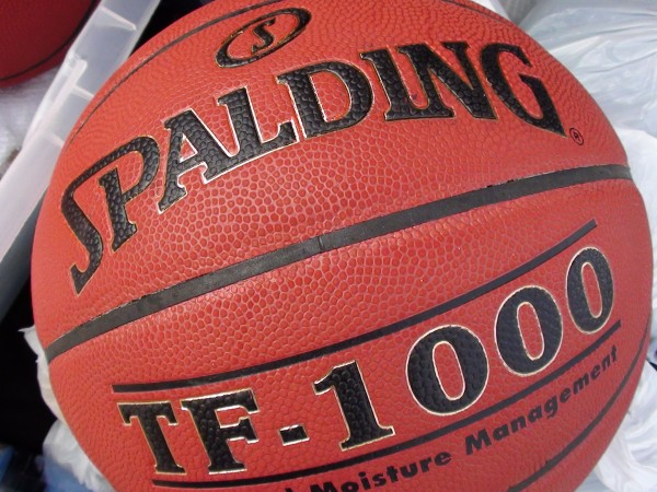 The Spalding TF-1000, a light basketball with a bit of a red tint, is no longer the official ball of the OIA and HHSAA. (Paul Honda / Star-Advertiser)