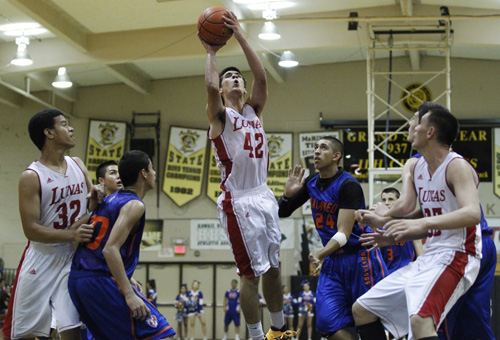 Lahainaluna's Jose Ryan Madera elevates for a shot during the second half of an HHSAA boys basketball playoff game between the Lahainaluna Lunas and the Kalaheo Mustangs on Wednesday, February 19, 2014 at McKinley High School in Honolulu. (Jamm Aquino / Star-Advertiser)