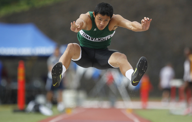 SPT - University High's Reece Alvarado competes in the boys long jump event during the 2014 HHSAA Track and Field Championships on Saturday, May 10, 2014 at Kamehameha-Kapalama Schools in Honolulu.  (The Honolulu Star-Advertiser/Jamm Aquino).