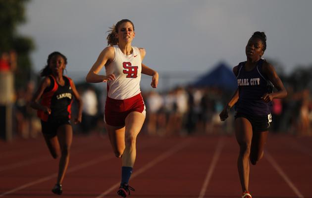 Seabury Hall's Alyssa Bettendorf, middle, took first in the girls 200-meter dash.