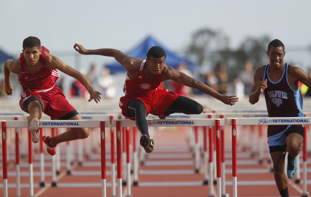 Lahainaluna's Emerson Liburd, middle, competed with Kalani's Raymond Alves, left, and Baldwin's Anthony Kahoohanohano in the boys 110-meter hurdles.
