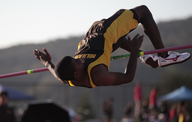 Mililani's Khalil Stevens attemped a jump at of 6-feet, 9 1/4 inches in the boys high jump.