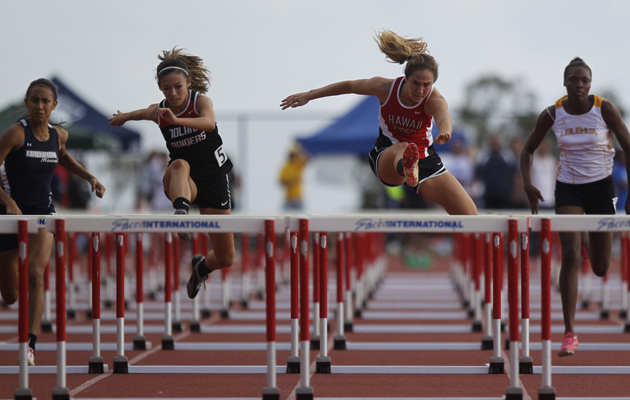 Hawaii Prep Academy's Emma Taylor, second from right, led the way during the girls 100-meter hurdles.