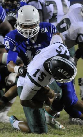 Kailua's Christian Mejia dropped Aiea's quarterback Jordan Liilii on Saturday. HSA photo by Bruce Asato