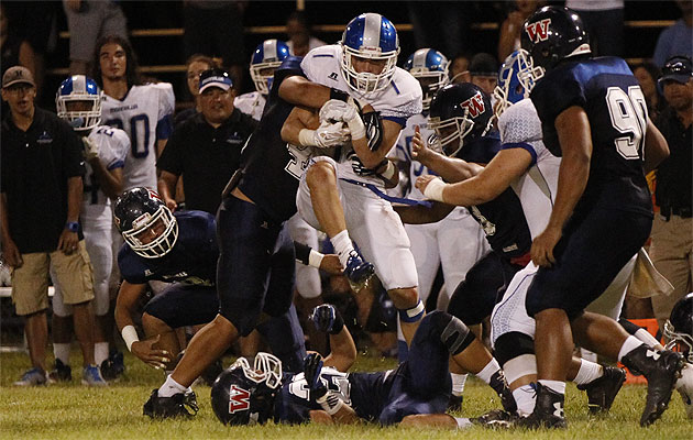 Waianae's Justice Jardine, left, tackled Moanalua's Michael Feliciano during Na Menehunes' win on Friday. Honolulu Star-Advertiser photo by Krystle Marcellus